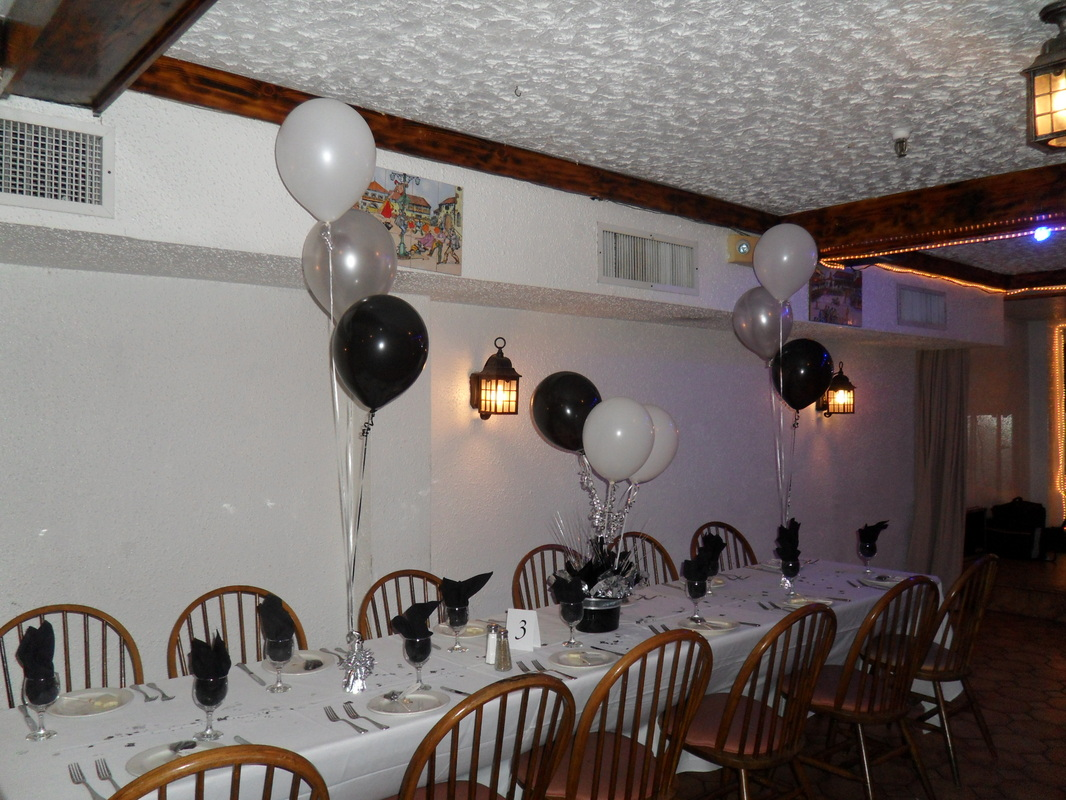 Picture I USED BLACK SILVER AND WHITE BALLOONS FOR THE CENTERPIECES