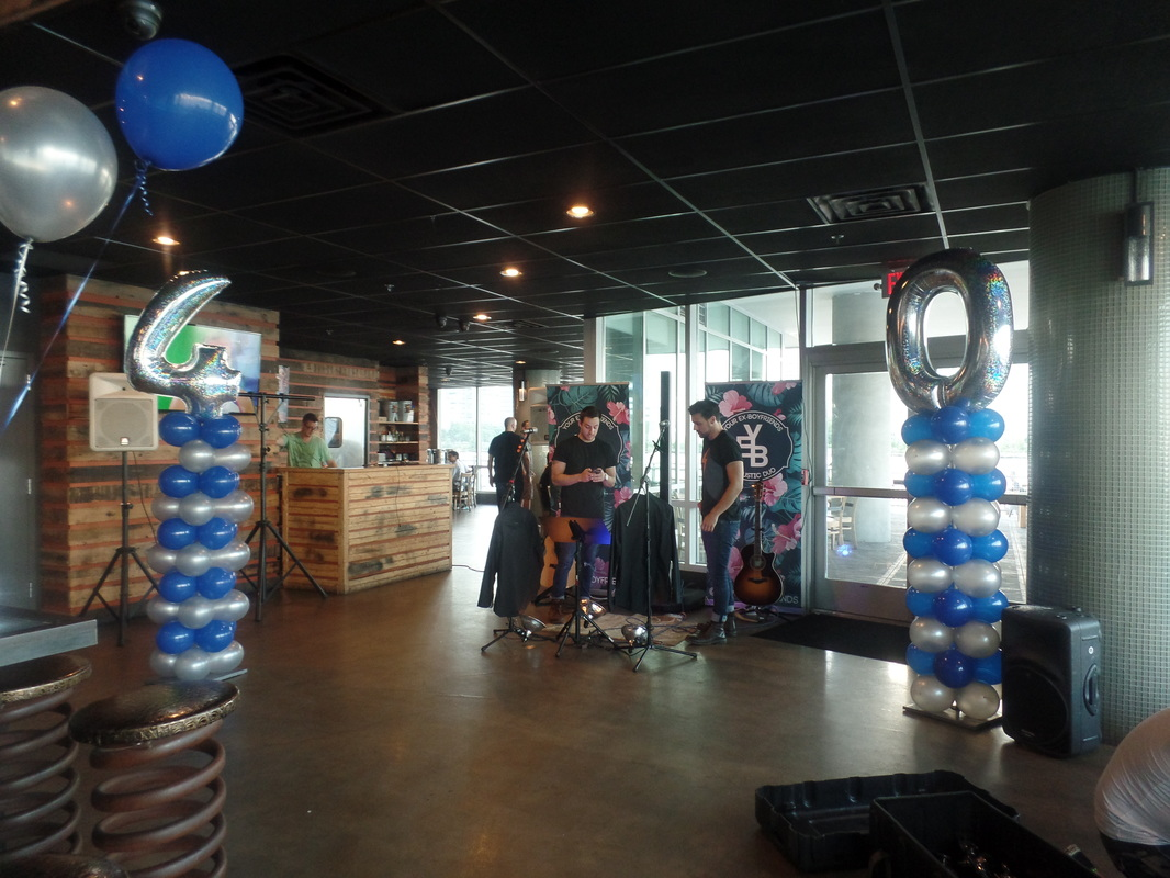 For My Clients 40th Birthday Party I Created Two Columns Using Dark Blue And Silver Balloons The Toppers Were Foil Numbers In Holographic